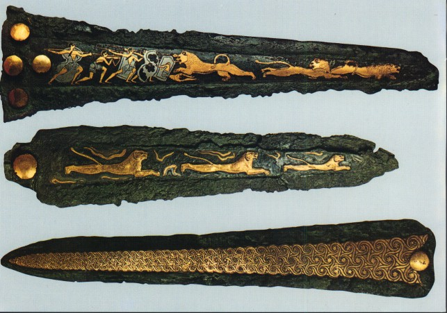 Mycenaean daggers bearing leonine artwork and swirly patterns